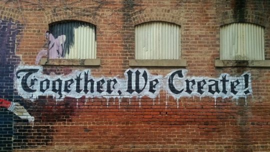 Together We Create words on a wall